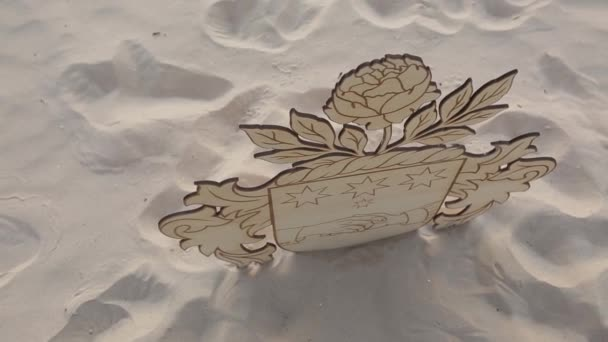 The Coat Of Arms Of Latvia From Plywood On The Beach Wedding