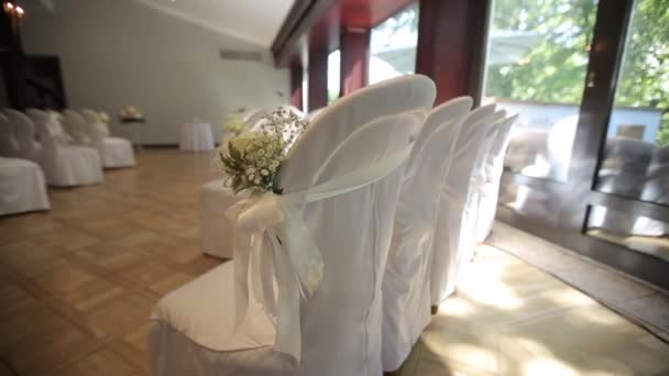 Place of wedding ceremony and decorated chairs Wedding decorations for the bride Bijouterie, ribbons, satin decorations and jewelry