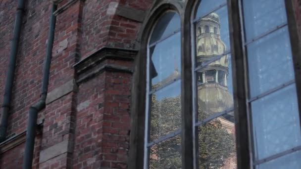 Church tower in the reflection of glass