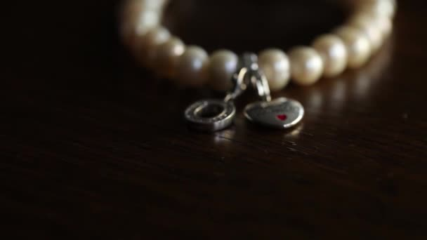 Silver Heart and Yellow Pearl Jewelry with stone Macro shooting travel on the slider