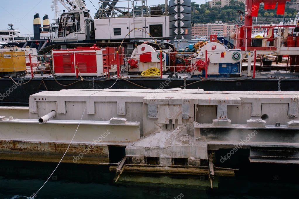 Construction crane afloat in the port of Monaco