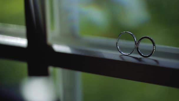 Silver Wedding Rings on the window with sunlights light flares macro closeup shoot diamon Jewellery