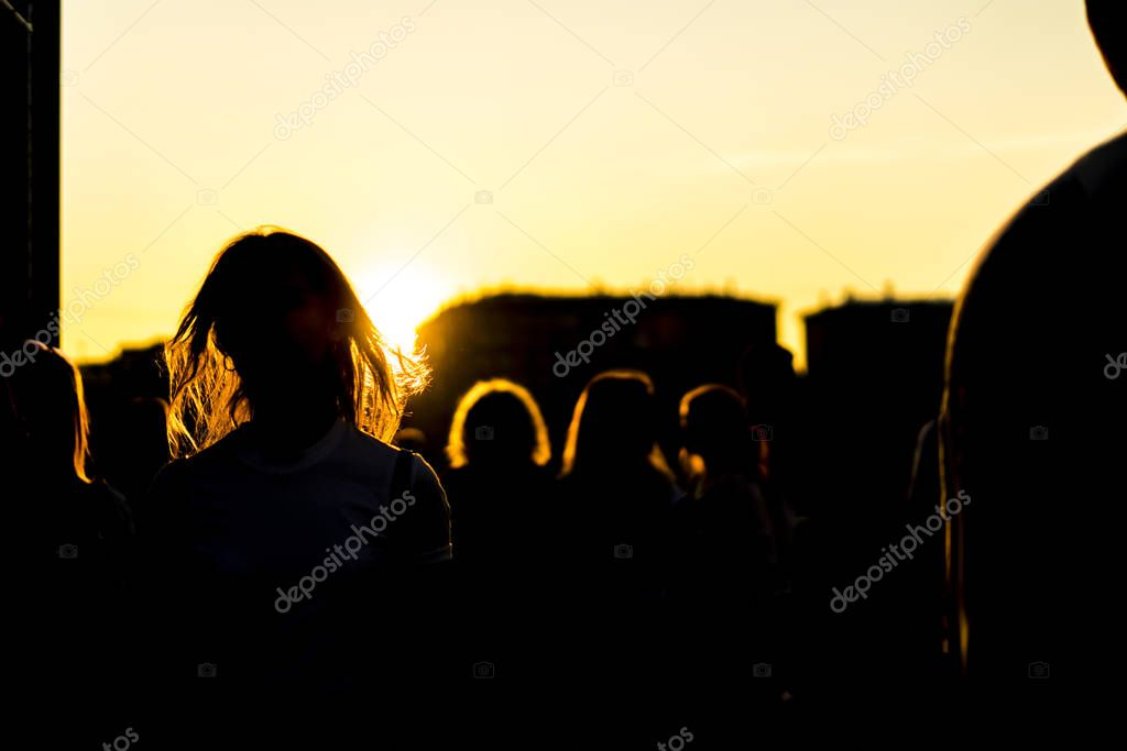 silhouette of crowd people in city on a  sunet