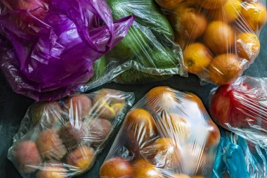 plastic packages begs with fresh fruits veggies after the markets