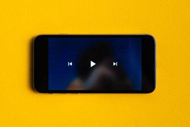 close up play button interface on a modern gadget when watching videos