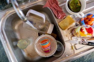 a huge bunch of dirty dish in the kithcen in the sink, housework concepts