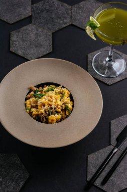 Spanish paella on a black background