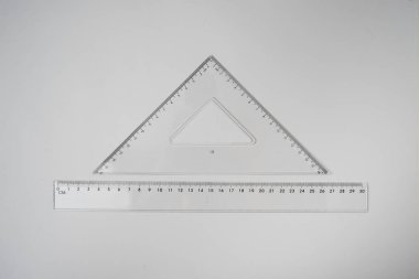 Set of multiple plastic rulers and the protractor, isolated over the white background