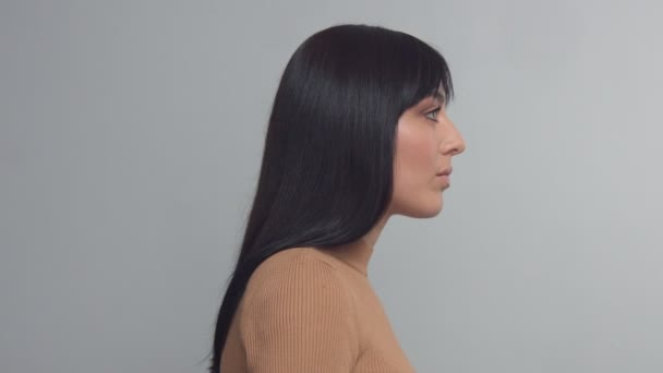 MIxed race brunette woman with blue eyes in studio