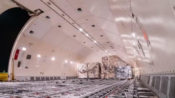 Panning time lapse unloading cargo inside cargo plane