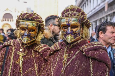 Italy, Venice - 2.3.2019 Colorfull mask and clothes during the Venice Carnival 2.3.2019 in Venice, Italy