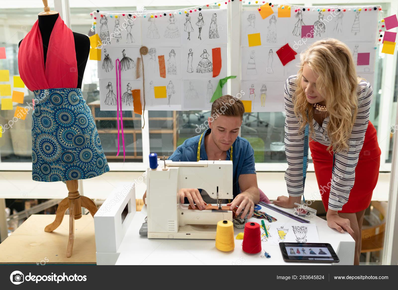 Front View Caucasian Male Fashion Designer Using Sewing Machine Table Stock Photo C Wavebreakmedia 283645824