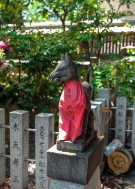 Stone sculpture of inari fox symbol statue at osaka shrine