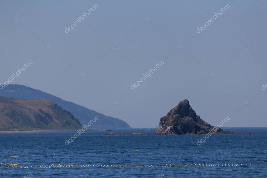 Cape Stolbchaty. Cape on the west coast of the island of Kunashir. It is composed of layers of basaltic lavas of the Mendeleyev volcano.