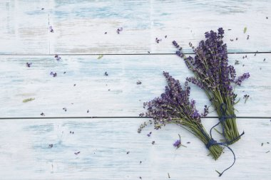 bunches of lavender flowers on white wooden table
