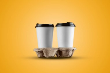 Paper white coffee cup isolated on a yellow background. mockup, layout, copy space