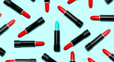 Set of red lipsticks with blue in the center isolated on blue color background. Colorful Tones, Lipstick tints palette, Makeup and Beauty. Beautiful Make-up concept. lipgloss.