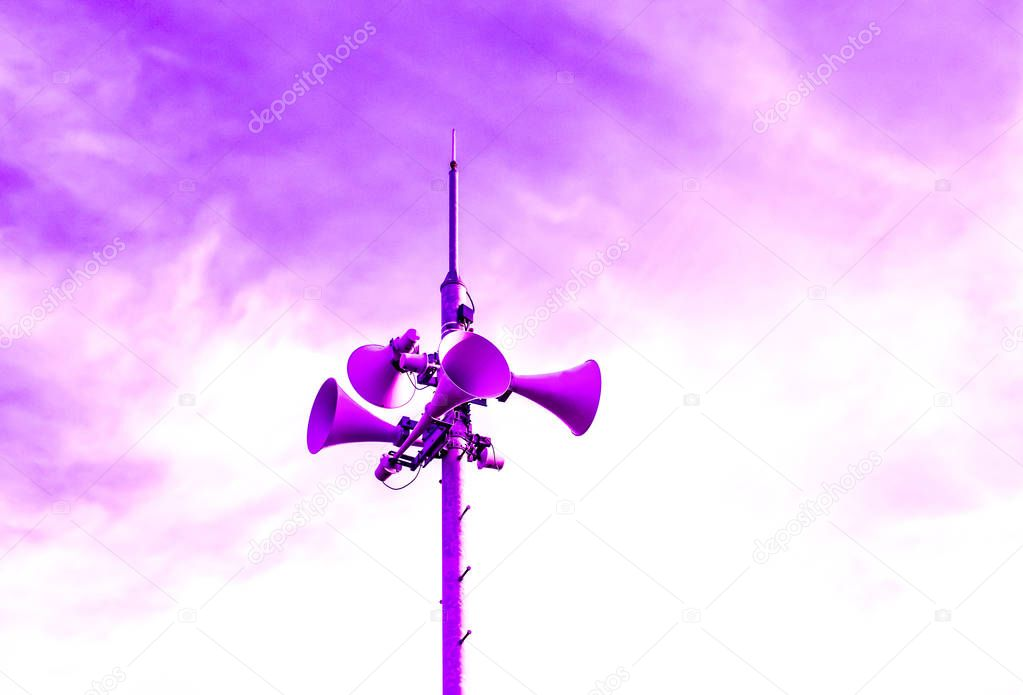 Loudspeaker to be used for the announcement of the event of a disaster.loudspeaker of disaster-forecast with pink, purple, dark blue sky.