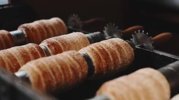 Czech national street food called trdlo trdelnik is being cooked during Christmas time and all year too.