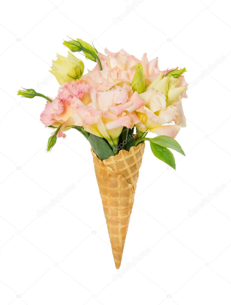 Waffle cone with flower bouquet isolated on white background.