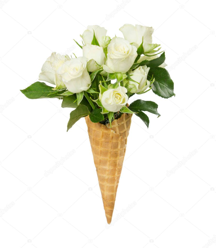 Waffle cone with flower bouquet from white roses isolated on white background.