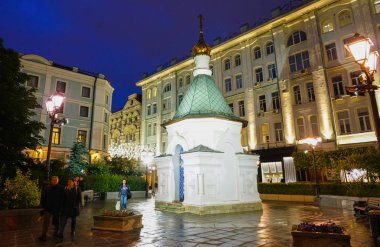 Moscow - July 2019: Orthodox chapel in Stoleshnikov Lane. Night view.