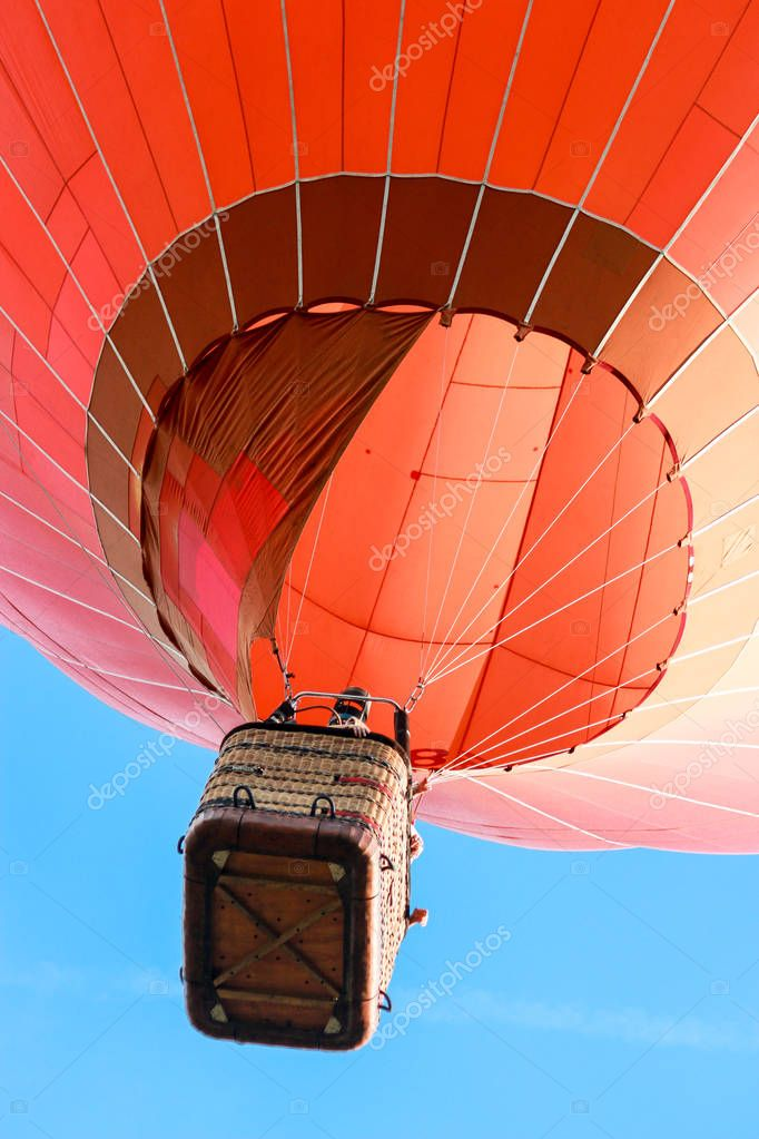 Red hot air balloon, view from ground
