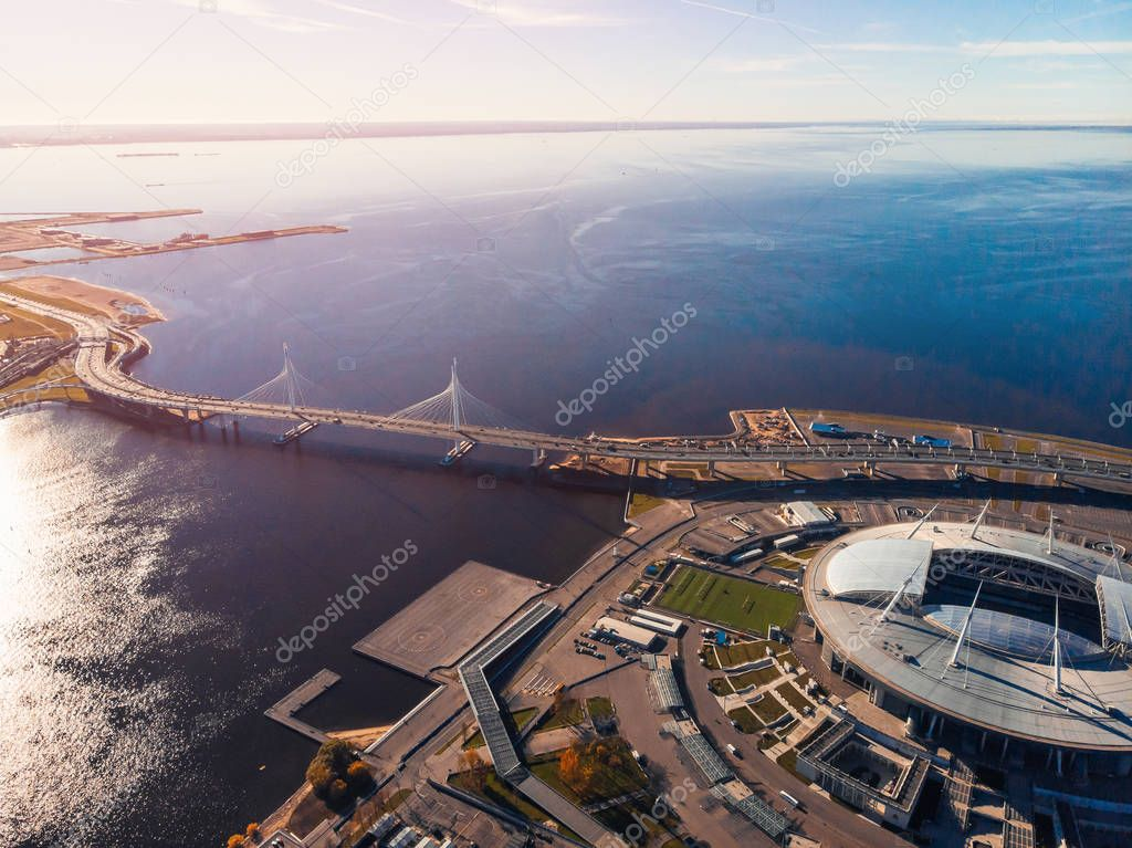 Stadium St. Petersburg. Zenit Arena. Gulf of Finland. Clear autumn day. Blue sky. Helipad. Sun glare