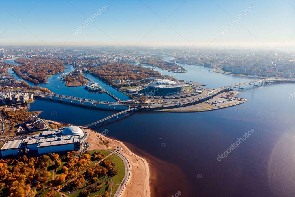 Stadium St. Petersburg. Zenit-Arena. Gulf of Finland. Coastline. Clear autumn day. Blue sky. Pedestrian bridge. Highway