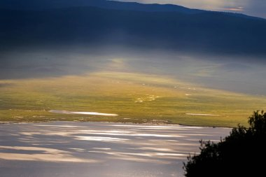 Scenic morning view of seasonal salt lake, Lake Magadi, also called Makat, center of Ngorongoro Crater Conservation Area in Tanzania, East Africa