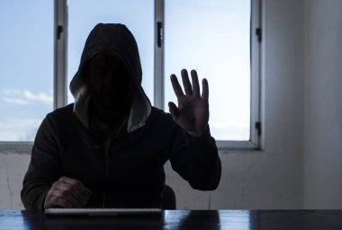 Hacker with laptop. Window in background