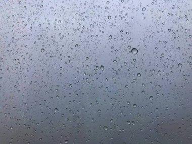 The rain drop on the high building window during the heavy rain in Bangkok, Thailand