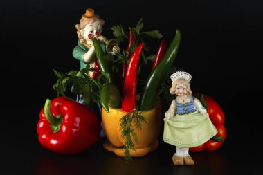 Sweet and hot peppers, and clown and girl figures