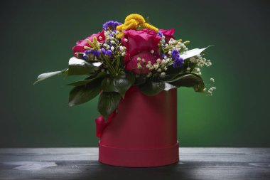 Bouquet of flowers on a green background