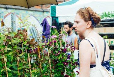 Young woman choosing plants