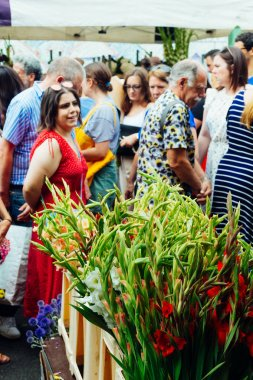 People walking along at the Columbia Road Flower Market