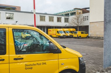 Bad Kissingen/Germany-31/12/18: Deutsche Post DHL Group auto fleet on a car parking near Post Office on Munchner Street. Deutsche Post DHL Group is the world's largest courier company