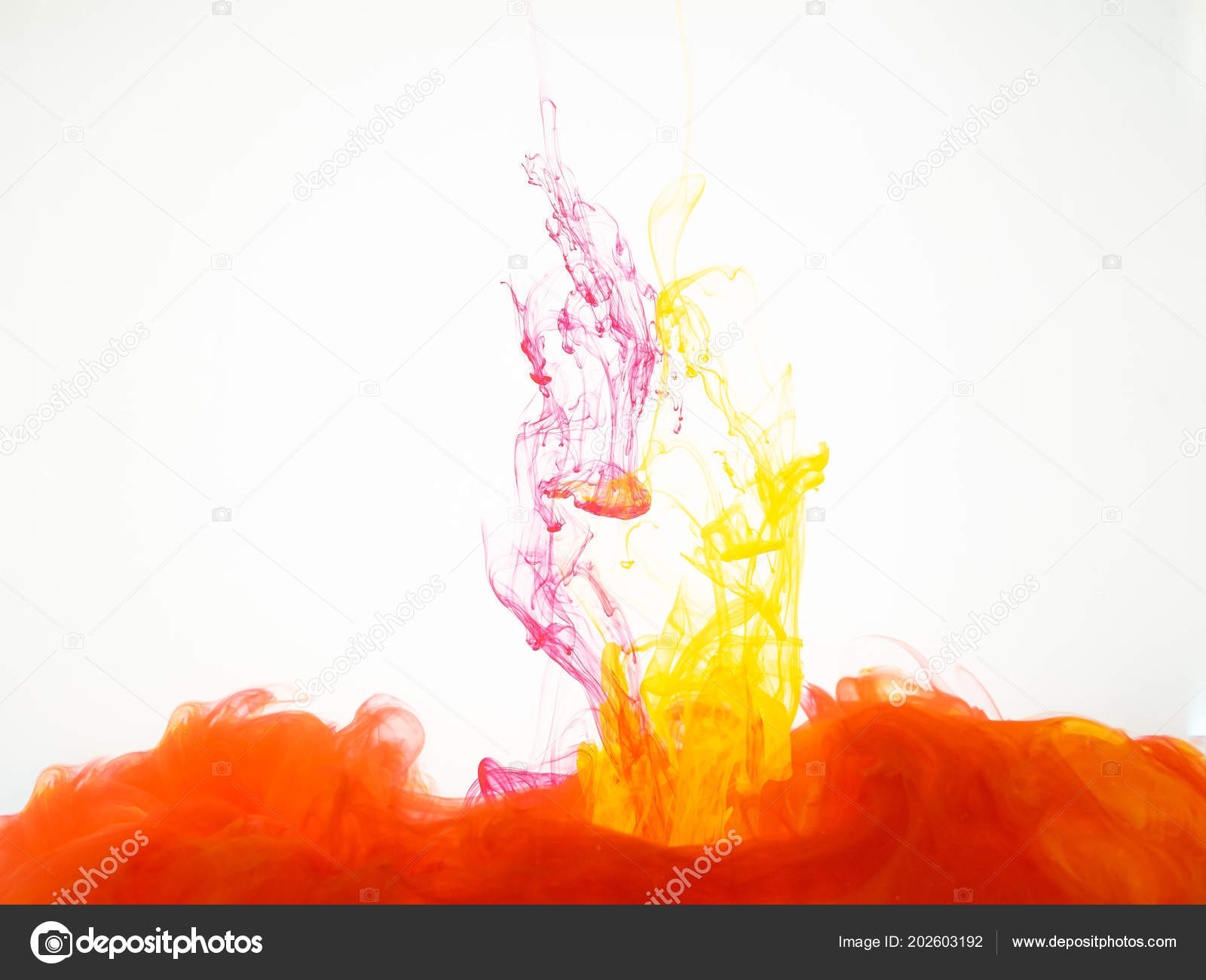 Colourful explosion of acrylic ink isolated on white