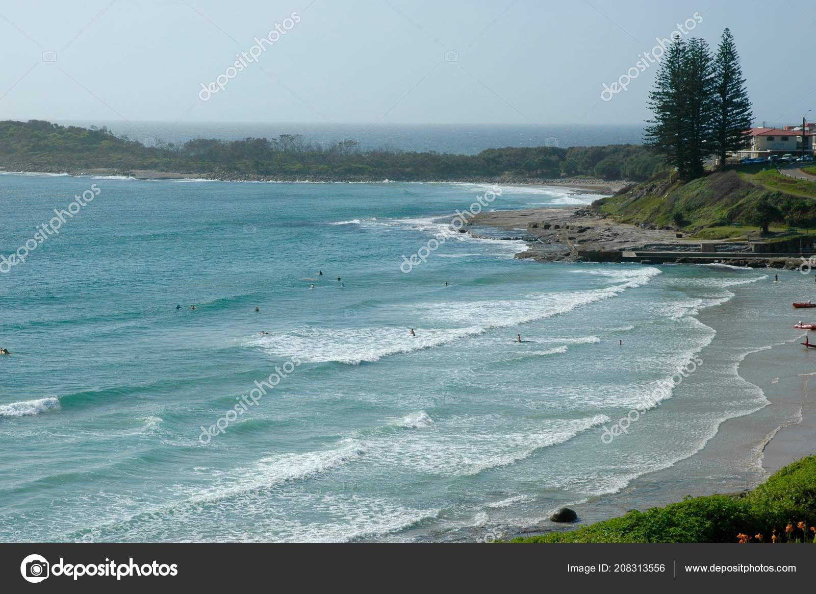 Surfers Paddling Out Catch Waves Australian Beach Headland