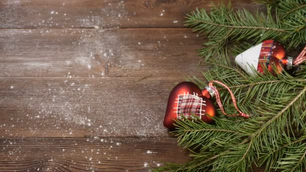 New Year and Merry Christmas 2019 2020. christmas tree with decorations on  wooden background. it is snowing