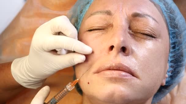 Facial cosmetology. Close up of female client getting face injections. Senior female patient ivisit beautician. Doctor makes injection. 4k