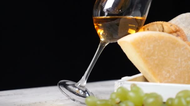 Restaurant cheese art. Variety of hard cheese put in a beautifully composition. Wine is poured in glass. Wine and appetizer concept. Luxury restaurant concept. Food art. hd