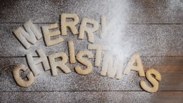 Happy New Year Concept Merry Christmas Note Written With Cookies Letters On Brown Wooden Background White Powder Falling Down In Slow Motion Hd