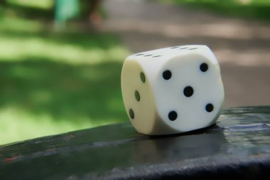 Close-up dice with defocused background, chance for winning