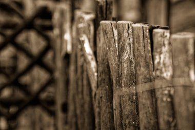 Medieval wooden stock, old wooden fence facade