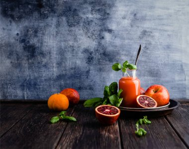 Delicious blood oranges juice in glass on rustic wooden board stock vector