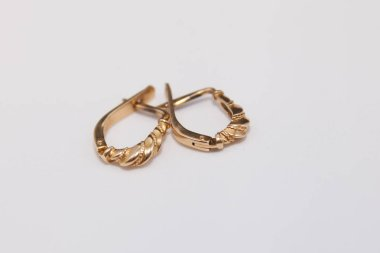 golden earrings on a white background