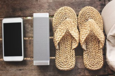 Bluetooth speaker smart phone and sandals beach summer concept