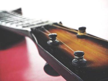 Guitars ukulele on pink background