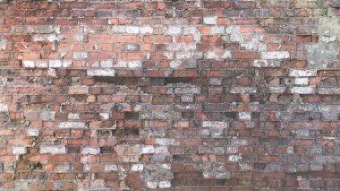 Torn brickwork for background.